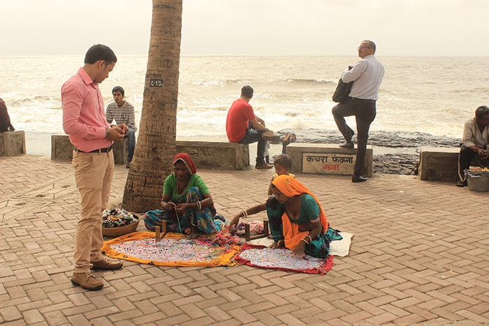 Bracelet and garland maker on sea side mUmbai