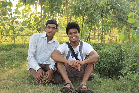 Indian boys resting in fields