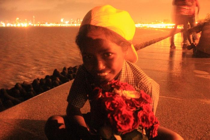 Rose flower seller kid at marine drive mumbai